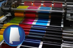 al map icon and an offset printing press with CMYK ink rollers