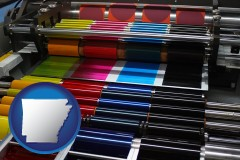 arkansas map icon and an offset printing press with CMYK ink rollers