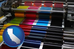 california an offset printing press with CMYK ink rollers