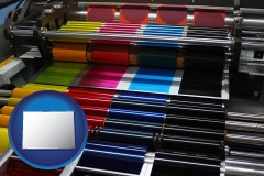 colorado an offset printing press with CMYK ink rollers