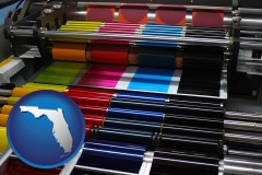 fl map icon and an offset printing press with CMYK ink rollers
