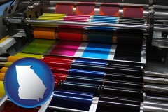 ga map icon and an offset printing press with CMYK ink rollers