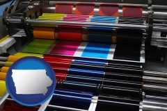 ia map icon and an offset printing press with CMYK ink rollers