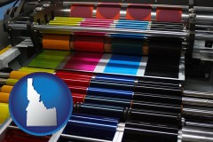 id map icon and an offset printing press with CMYK ink rollers
