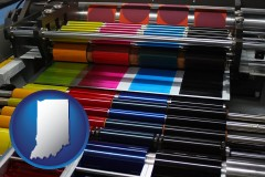 in map icon and an offset printing press with CMYK ink rollers