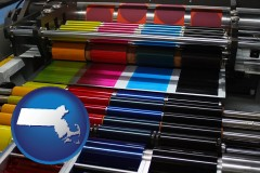 massachusetts an offset printing press with CMYK ink rollers