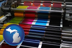 michigan an offset printing press with CMYK ink rollers