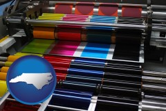north-carolina map icon and an offset printing press with CMYK ink rollers