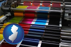 nj map icon and an offset printing press with CMYK ink rollers