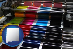 nm an offset printing press with CMYK ink rollers