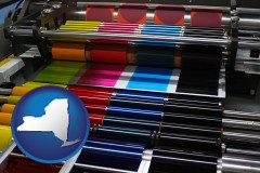 ny map icon and an offset printing press with CMYK ink rollers