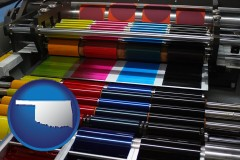 ok map icon and an offset printing press with CMYK ink rollers
