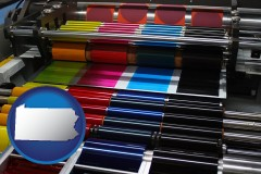 pa map icon and an offset printing press with CMYK ink rollers