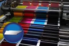 tn map icon and an offset printing press with CMYK ink rollers