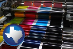 tx map icon and an offset printing press with CMYK ink rollers