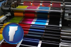 vermont an offset printing press with CMYK ink rollers
