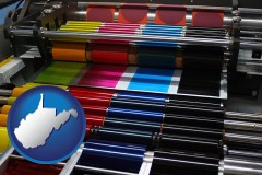 wv map icon and an offset printing press with CMYK ink rollers