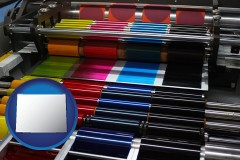 wyoming an offset printing press with CMYK ink rollers