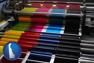 an offset printing press with CMYK ink rollers - with Delaware icon