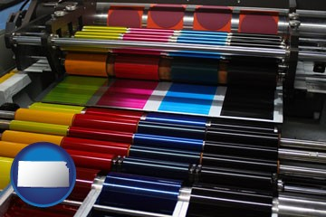 an offset printing press with CMYK ink rollers - with Kansas icon