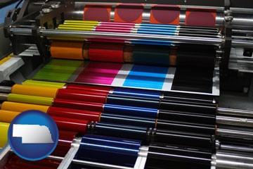 an offset printing press with CMYK ink rollers - with Nebraska icon