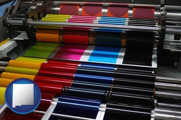 an offset printing press with CMYK ink rollers - with New Mexico icon