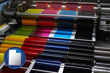 an offset printing press with CMYK ink rollers - with Utah icon