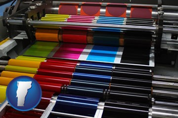 an offset printing press with CMYK ink rollers - with Vermont icon