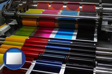 an offset printing press with CMYK ink rollers - with Wyoming icon